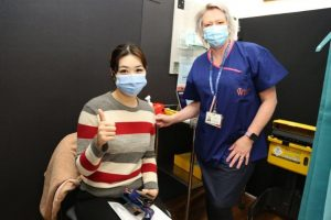 Young woman at the Warragul vaccination clinic with nurse